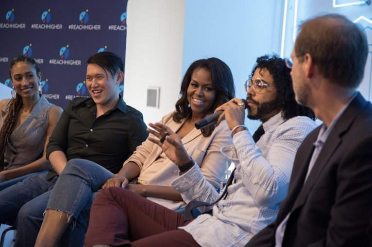 "Ryan Liu, former ISPS Director's Fellow, with Michelle Obama at Summit on ""Beating the Odds"""
