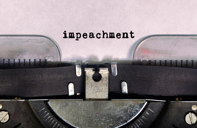 Old typewriter spelling 'impeachment'